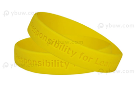 Yellow Solid Debossed Rubber Bracelets